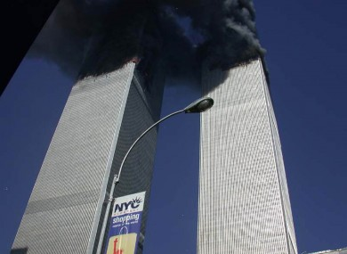 Plumes of smoke pour from the World Trade Center towers in New York Tuesday, Sept. 11, 2001.