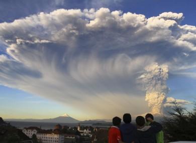 Children watch the Calbuco volcano erupt.