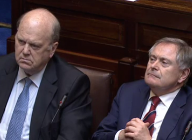 Michael Noonan and Brendan Howlin listening to considerable criticism of their speeches earlier