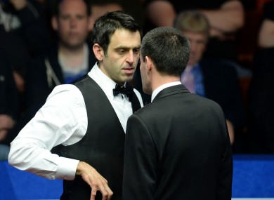 Ronnie O'Sullivan is spoken to by referee Olivier Marteel in his second round match against Matthew Stevens.