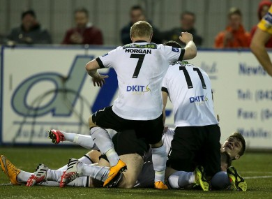 The Lilywhites celebrate their late goal