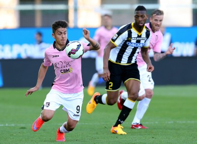 Palermo's Paulo Dybala, left, controls the ball past Udinese's Molla Wague.