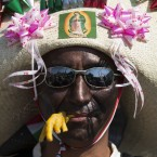 A man dressed as a Zacapoaxtla Indian, carrying a fake chicken's foot in his mouth, marches in a parade as residents prepare to reenact the battle of Puebla, between Zacapoaxtla Indians and the French army, during Cinco de Mayo celebrations in Mexico City.<span class=
