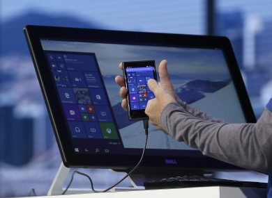 Joe Belfiore, Microsoft Corporate Vice President of Operating Systems Group, demonstrates Continuum for phones at the Microsoft Build conference in San Francisco last month.
