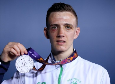 Irvine: battered and bruised but returning home with a medal.