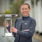 Maria McCambridge holds the trophy after winning today's race. <span class=