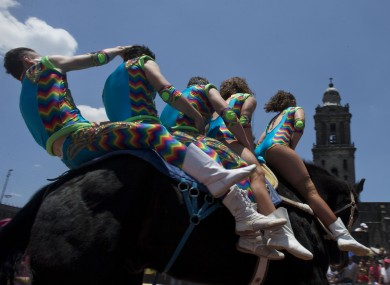 Circus performers ride five to a horse during a free public show to protest Mexico City's ban on circus animals last summer.
