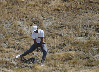 Tiger Woods hits out of the tall fescue grass on the eighth hole during the second round of the US Open.