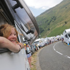 A woman watches the riders pass from the window of a camping car during the twelfth stage of the Tour de France cycling race over 195 kilometers (121.2 miles) with start in Lannemezan and finish in Plateau de Beille, France, Thursday, July 16, 2015.<span class=
