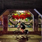 A bicyclist passes through the Krog Street Tunnel Wednesday, July 15, 2015, in Atlanta. The tunnel runs under train tracks carrying freight cars and is known for its urban street art. Connecting the eclectic neighborhoods of Cabbagetown and Inman Park, the tunnel also serves as a message board with frequently updated posts about local events and shows. <span class=