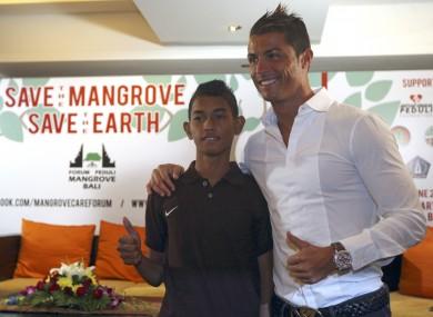Martunis with Cristiano Ronaldo in 2013.