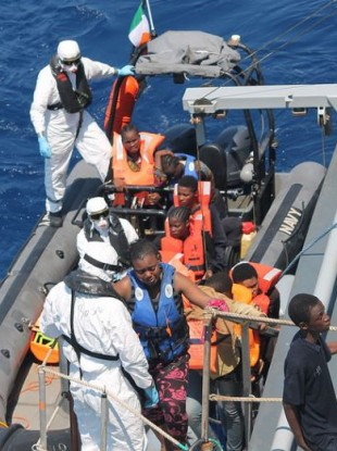 The crew of the LÉ Niamh at work in a rescue operation on Sunday.