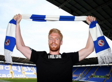 McShane wearing a t-shirt with the words 'I feel love' at the Madejski Stadium.