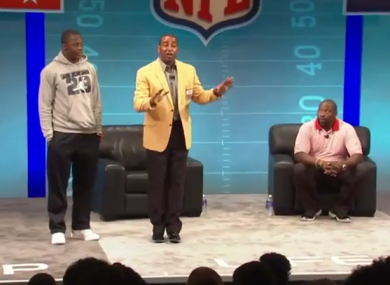 Cris Carter (yellow) and Warren Sapp dispensing their 'advice' to the rookies.