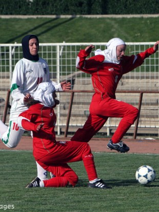 Niloufar Ardalan (pictured on left in white) in action for her country in 2006 in a friendly in Tehran.