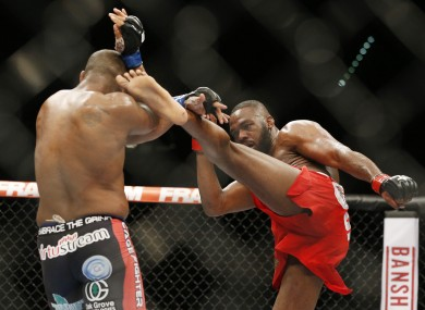 Jones kicks Daniel Cormier during their light heavyweight title bout at UFC 182 in January.