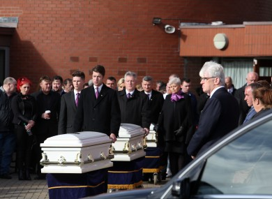The remains of the three Connors children are taken from the church.