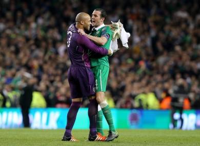 Ireland goalkeeper Darren Rabdolph and John O'Shea celebrate after the game.
