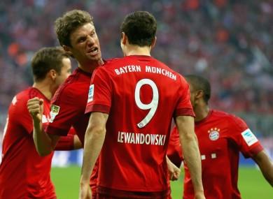 Bayern Munich team-mates Thomas Muller and Robert Lewandowski celebrate against Borussia Dortmund.