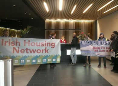 Activists display banners in the reception area of Blackstone's Dublin offices