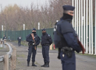 Police officers patrol outside the venue of the United Nations Climate Change Conference in Le Bourget, outside Paris.