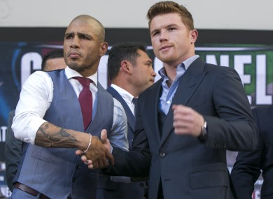 Cotto (left) and Canelo shake hands at the announcement of the fight.
