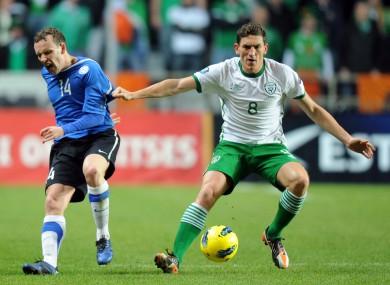 Estonia's Konstantin Vassiljev, left, fights for the ball against Keith Andrews.