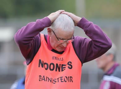 Mickey Moran dejected after watching his side suffer defeat.