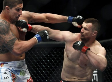 Mirko 'Cro Cop' (right) trades punches with Brendan Schaub during their 2011 bout at UFC 128.