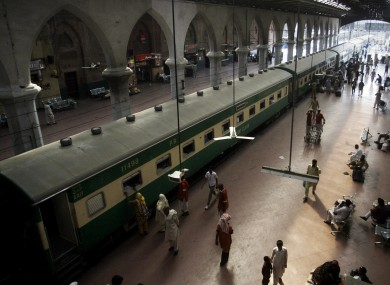 File photo: Passengers board a train at the Lahore railway station in Pakistan.