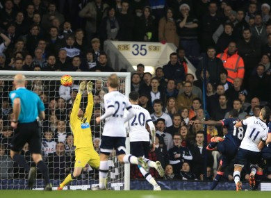 Newcastle United goalkeeper Rob Elliot (second left) saves an effort on goal by Tottenham Hotspur's Erik Lamela (second right).