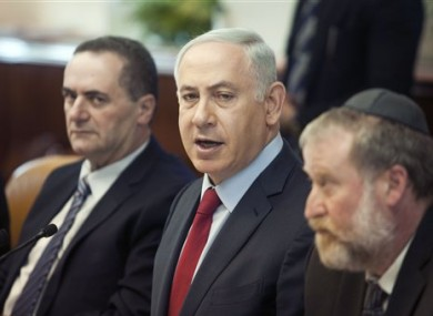 Israeli Prime Minister Benjamin Netanyahu, centre, attends a weekly cabinet meeting in Jerusalem yesterday.