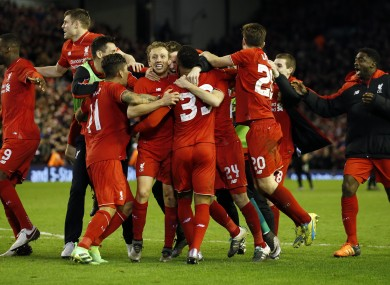 Liverpool's players celebrate after winning the English League Cup semi-final second leg.