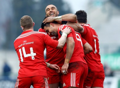 Conor Murray celebrates his try with his team-mates.
