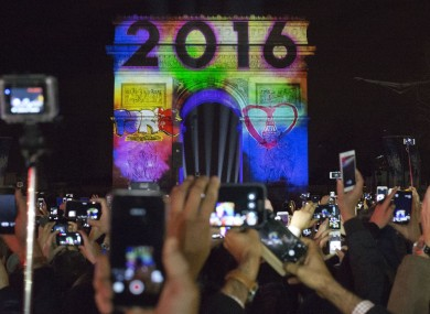 People celebrate the new year in front of the Arc de Triomphe in Paris, France.