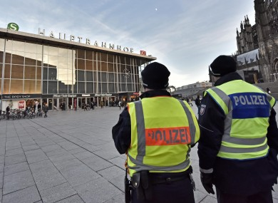 Police pictured outside the main train station in Cologne, Germany yesterday