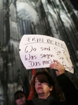 A woman demonstrates outside the cathedral in Cologne yesterday.