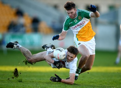 Offaly's Joe Maher and Kildare's Liam Healy in opposition today.