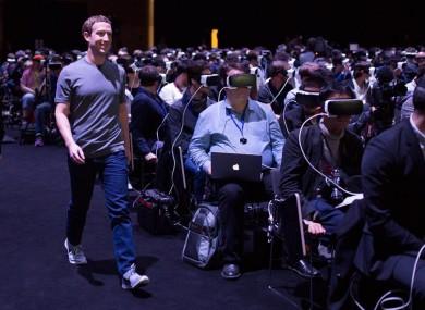 Mark Zuckerberg walking through a hall of people wearing Samsung Gear VR in Barcelona last night.