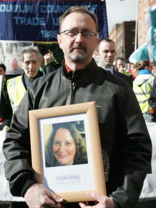 Conor Mac Liam pictured at a protest on the first anniversary of his wife Susie Long's death.