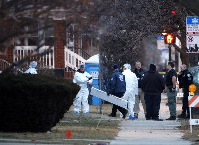 Chicago police investigators work outside the home where the bodies were found.