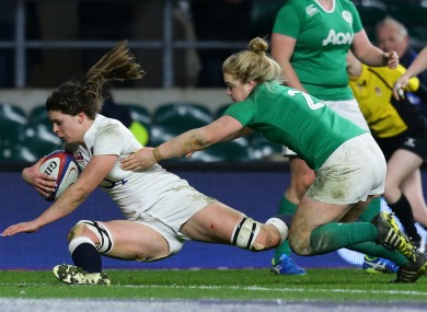 England's Abbie Scott (left) scores a try past Ireland's Cliodhna Moloney.