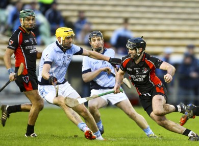 Na Piarsaigh's David Breen tries to stop Oulart-the-Ballagh's Eoin Moore.