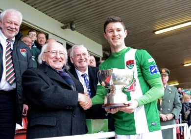 President Michael D Higgins presents Cork's John Dunleavy with the cup.