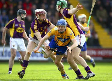 Clare's Shane O'Donnell is tackled by Patrick O'Connor and Cian Dillon of Wexford.
