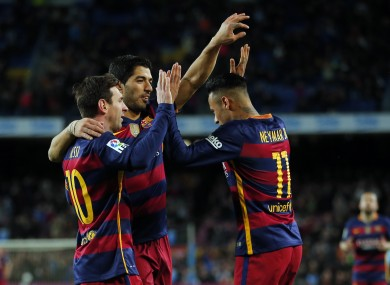 FC Barcelona's Neymar, right, celebrates a goal with his team-mates Luis Suarez, centre, and Lionel Messi against Celta Vigo.