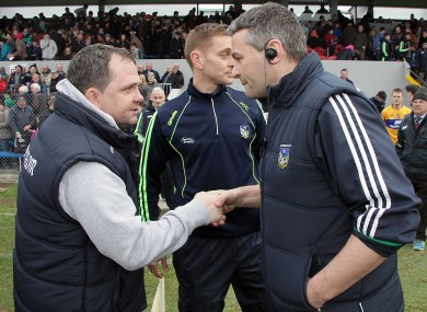 Clare boss Davy Fitzgerald and Limerick manager TJ Ryan shake hands after the game.