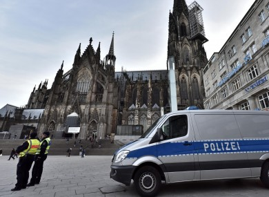 Police patrol in front of the main train station and the cathedral in Cologne.