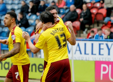 Burnley's Stephen Ward celebrates with Joey Barton after scoring his side's first goal of the game.