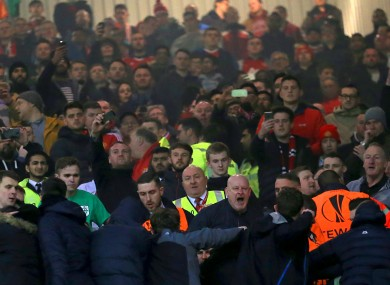 Steward try to calm the situation between rival fans last night.